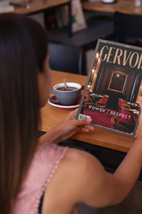 Woman reading Gervois magazine in a coffee